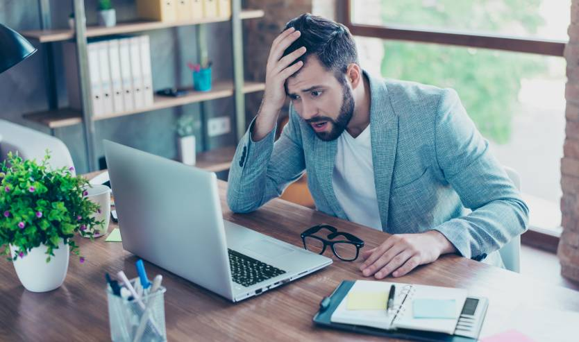 Businessman confused by his computer